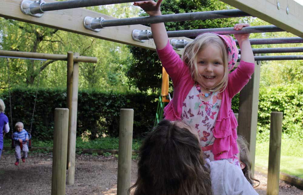 On the climbing frame in the children's play area